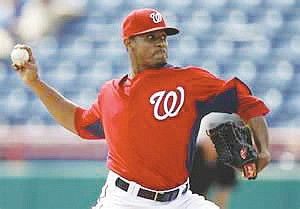 Pitcher Edwin Jackson may need to glance at the front of his jersey to remind himself which Major League Baseball ...