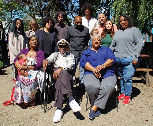 A number of artists and creators were involved with the Alberta St. art markers that feature Paul Knauls Sr. and Donna Hammond (center), and six other African American history makers of the region.