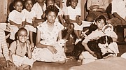 A historic photo shows Sen. Jackie Winters as a child with her dog, Tippy, and her doll, the only possessions she had after surviving the 1948 Vanport Flood. A small business owner in both Portland and Salem and the only African-American Republican to be elected to the legislature Winters died May 29 at the age of 82.