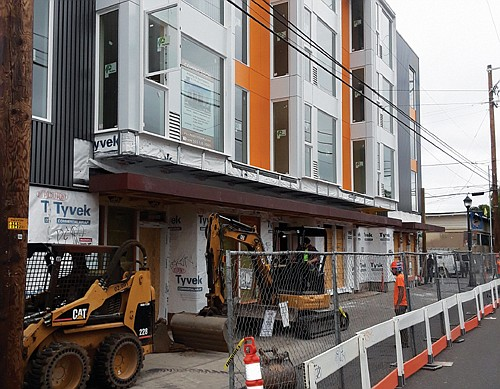 Construction workers put the finishing touches on the Alberta 13 Apartments, the culmination of an 18 month build and representing ...