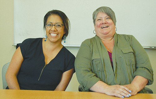 Fabiola Casas (left) and Anna McDonald serve the public as financial assistance program specialists for the Portland Water Bureau, positions that have been added to the staff at Portland Water Bureau as part of an enhancement to its Financial Assistance Program.