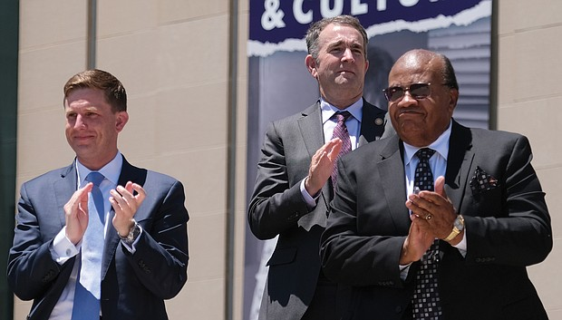 From left, Jamie O. Bosket, president and chief exeuctive officer of the Virginia Museum of History & Culture; Gov. Ralph S. Northam; and the Rev. Grady W. Powell, retired pastor of Gillfield Baptist Church of Petersburg and a member of the museum's board, applaud during the ceremony.(Sandra Sellars/Richmond Free Press)