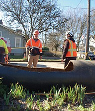 Portland Water Bureau crews examine a broken 30-inch cast iron pipe that had burst beneath Northeast Skidmore Street, between 23rd and 24th Avenues, last March 26, flooding basements .Last week, the city council agreed to pay for the damages caused by the break.