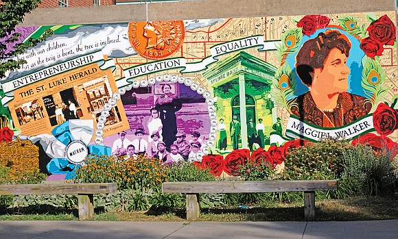 This dramatic mural graces the back entrance of Maggie L. Walker Governor's School at Lombardy and Leigh streets.