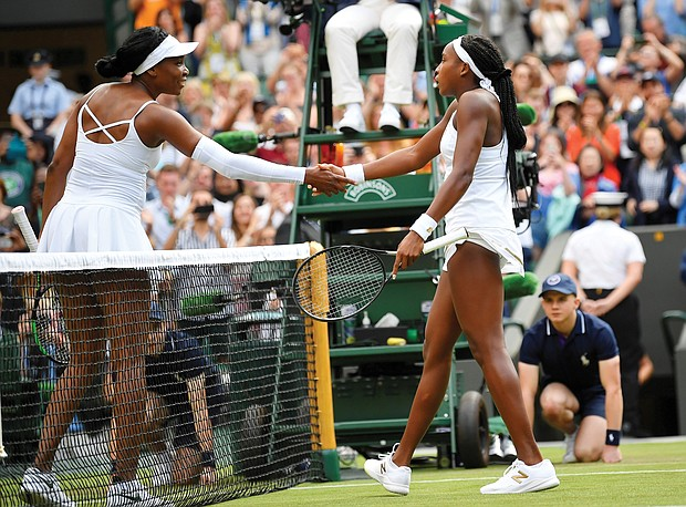 Cori Gauff, 15, receives a congratulatory handshake from her 39-year-old opponent Venus Williams after the teen beat the tennis champion 6-4, 6-4 Monday at Wimbledon. Gauff's next match is Wednesday.