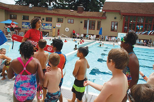 """A lifeguard has some tips for young swimmers on how to complete the """"swim test"""" to use the deep end on the first day of operations Monday at the new Peninsula Pool.  The historically multicultural hub at North Rosa Parks Way and Albina Avenue will officially celebrate its recently completed pool reconstruction with a free grand reopening and pool party on Thursday, July 18 featuring free swimming, cake, and more."""