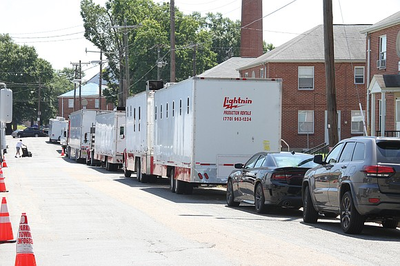 Production trucks line Calhoun Street in Richmond's Gilpin Court Tuesday where NBA star Kevin Durant, formerly of the Golden State ...