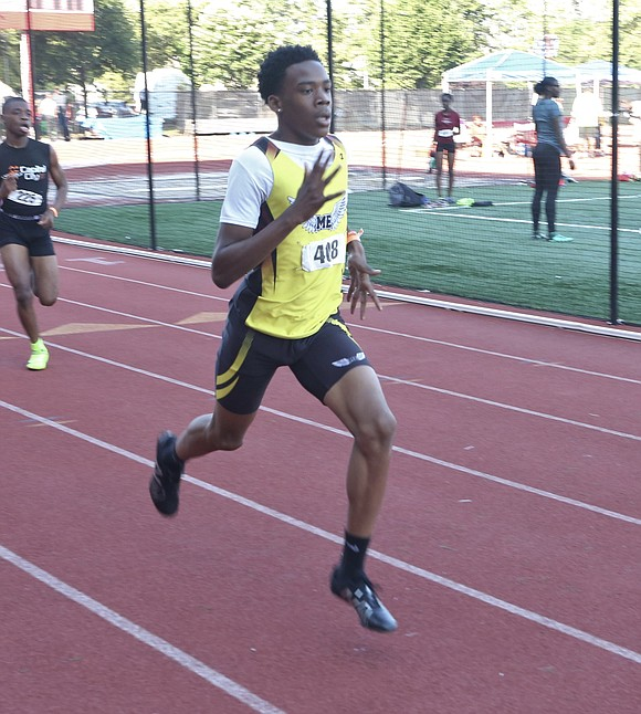 St. John's University track and field coach James Hurt said he's never seen so many spectators at a meet on ...