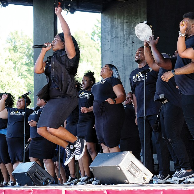 Members of Richmond's In His Presence Conference Choir lift the spirits of hundreds of people attending the 10th Annual Gospel Music Festival on Sunday at Dogwood Dell. The free event was hosted by Sheilah Belle and Praise 104.7 FM as part of the City of Richmond's Festival of Arts. (Sandra Sellars/Richmond Free Press)