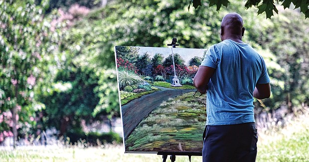Cityscape: Slices of life and scenes in Richmond:  Richmond artist Jeff Morris, known for his realistic landscapes featuring the city's beauty, takes advantage of the sunny weather to complete his latest painting featuring a flowering slice of Byrd Park. Location: Blanton Avenue and Grant Street across from Unity of Richmond. (Sandra Sellars/Richmond Free Press)
