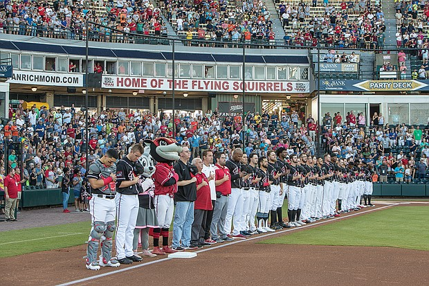 Top players from affiliates of Major League Baseball teams around the country pause for the Pledge of Allegiance at The Diamond before last week's All-Star Game.