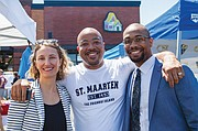 "Prosper Portland Executive Director Kimberly Branam, Champions Barbershop Owner Jamaal Lane (center) and Mayor Ted Wheeler's Deputy Chief of Staff Jamal Fox celebrate community and the rebuilding of African American culture and prosperity in the heart of the historic black community at the grand opening celebration of Alberta Commons, ""Dream Street,"" on Northeast Martin Luther King Jr. Blvd."