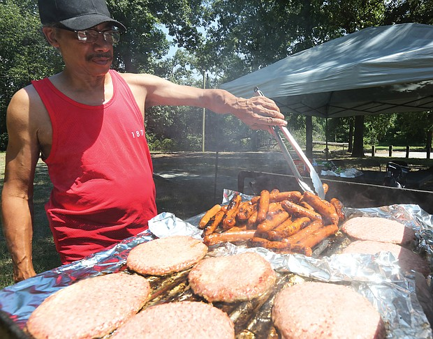 Black Pride RVA/ Sam Patterson, 62, handles the grill at last Saturday's Pride in the Park Tailgate Party, the final event of the 2nd Annual Black Pride RVA. The four-day festival was designed to promote the health and wellness of the black LGBTQ community through celebration, education and empowerment. (Regina H. Boone/Richmond Free Press)