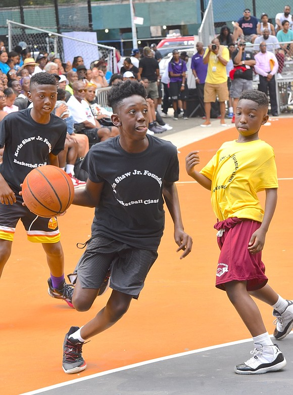 The Kevin Shaw Jr. Foundation showcased three youth basketball games Saturday afternoon, July 27, in Rucker Park on 155th and ...