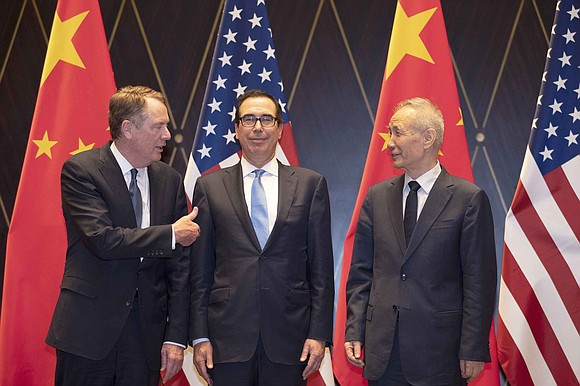 "President Donald Trump on Monday accused China of ""currency manipulation,"" shortly after Beijing struck back with its own retaliatory action ..."