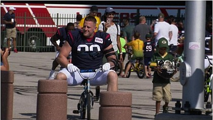 JJ Watt on a child's bike