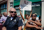 Trump supporters are not welcome on Wednesday near the site of the weekend mass shooting in Dayton, Ohio's Oregon District where nine people were killed and 14 wounded. Hundreds of people protested the president's visit to the city Wednesday.