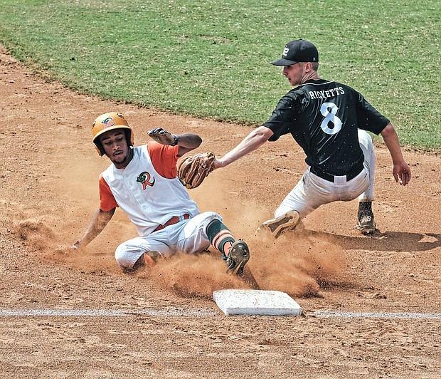 John Jimenez of the Baltimore Rattlers slides into third base as Stevie Ricketts of the Bowie Elite Black Sox tries to tag him out during the Metropolitan Junior Baseball League's Inner City Classic U-16 championship game on Sunday at RF&P Park in Glen Allen.