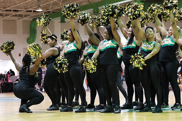 Huguenot's alumni cheerleaders show off some moves during the cheering competition, which they won.