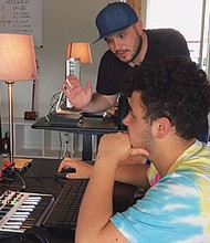 "Teen music producer Raymond Battaro receives instruction from Grant Burgess at a digital music workstation at ""Midschool,"" a new music education program in historic downtown Gresham that offers low cost and inclusive classes."