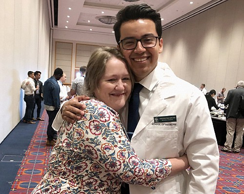 Christopher Ponce Campuzano, an OHSU medical student from the Class of 2023 gets a hug from mentor Carolyn Zook, a member of the undergraduate medical education program team. Campuzano is the first immigrant of Deferred Action for Childhood Arrival status in the school's most racially diverse incoming class.