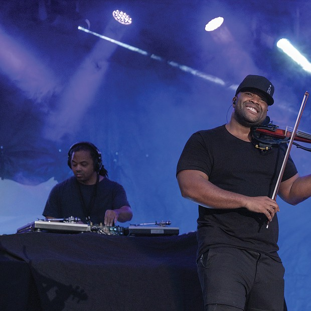 A member of the Florida-based hip hop duo Black Violin shows the crowd what he's got at the 10th Annual Richmond Jazz and Music Festival at Maymont.