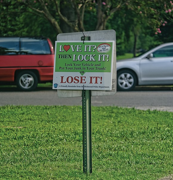 "A sign posted in Richmond's Byrd Park offers motorists a friendly reminder: ""Love It? Then Lock It! Or Lose It!"""