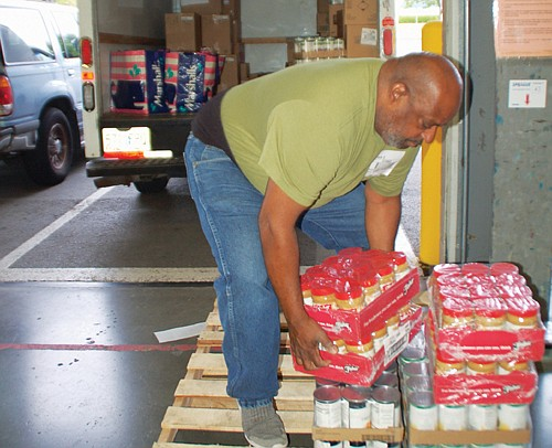 Kenneth Green of the Salvation Army collects food donations for distribution to needy families from the Oregon Food Bank in northeast Portland, Advocates for the hungry are bracing for a rule change from the Trump Administration that could kick three million people off of food stamps, including over 60,000 in Oregon.