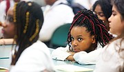 Cheyenne listens intently on the first day of classes at Cristo Rey Richmond High School. The school is located in the Museum District on Sheppard Street in the former home of Benedictine High School.