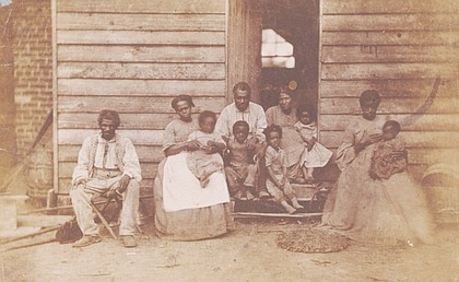 Enslaved people on a Hanover County plantation owned by Dr. William F. Gaines taken by photographer George Harper Houghton in 1862.
