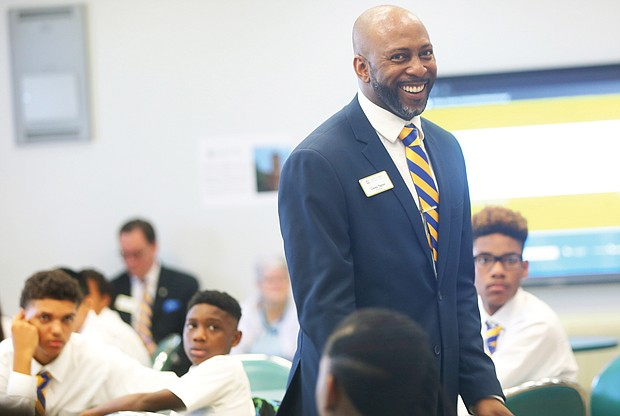 Corey Taylor, principal of Cristo Rey Richmond High School, welcomes members of the school's inaugural class Monday and sets expectations for the academic year.