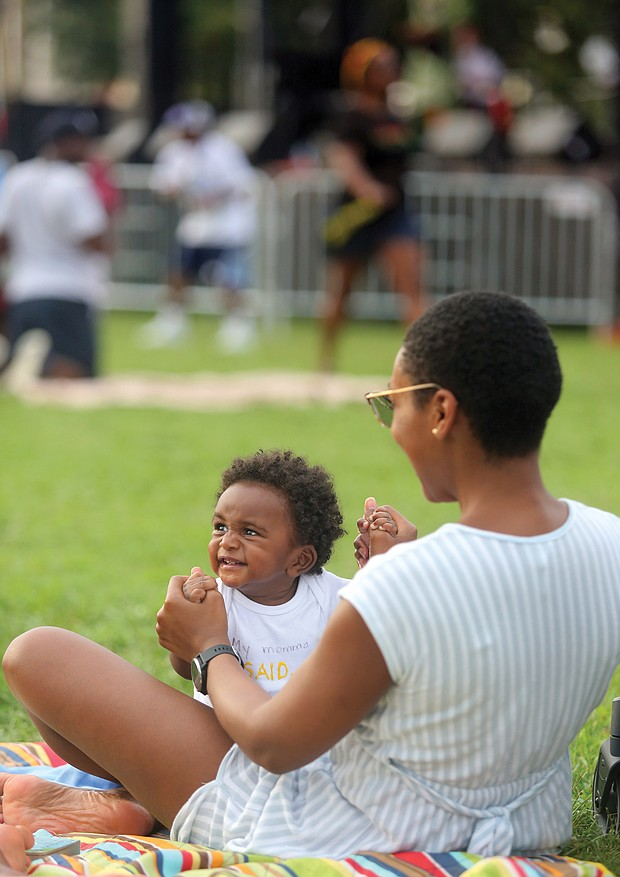 All smiles/ Eight-month-old Henry Tidwell was all smiles last Saturday as he and his mother, Whitney Tidwell, took in the sights and sounds at the 29th Annual Down Home Family Reunion at Abner Clay Park in Jackson Ward. (Regina H. Boone/Richmond Free Press)