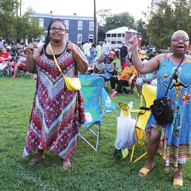 A 'Down Home' good time/ Music, food, entertainment and fun were the key ingredients last Saturday for the 29th Annual Down Home Family Reunion at Abner Clay Park in Jackson Ward. Hundreds of people turned out to enjoy the free event, hosted by the Elegba Folklore Society to celebrate African-American folk life. Sonya Eldridge and Andrena Graves are brought to their feet by the music. (Regina H. Boone/Richmond Free Press)