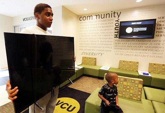Dominic Baah is one of thousands of Virginia Commonwealth University students who spent Saturday moving into campus dorm rooms.