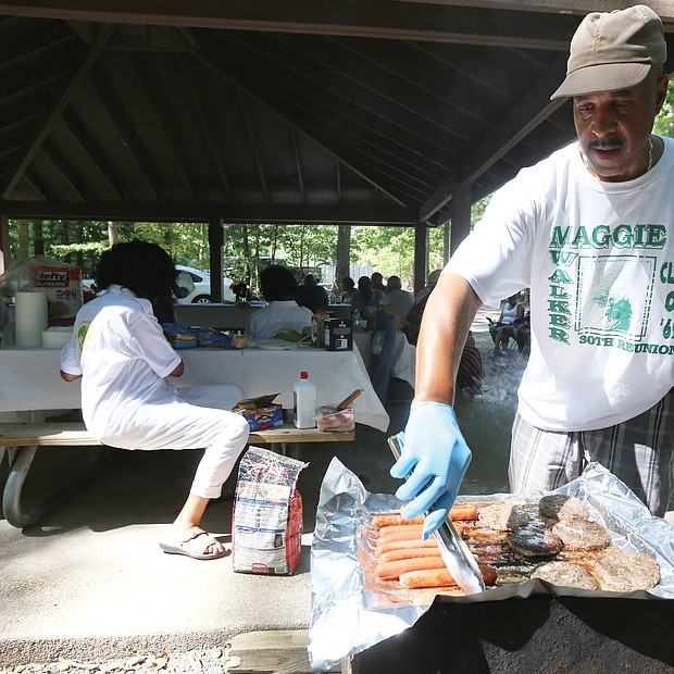 Green Dragons celebrate golden reunion/ The golden anniversary reunion wrapped up last Sunday with the cookout at Dorey Park in Henrico County, where classmate Elwood Sookins Jr. takes charge of the grill. The reunion committee organized three days of events that included a tour of the old high school on Lombardy Street; a class photo taken at the statue of Maggie Walker on Broad Street in Downtown; dinner and dancing at a Henrico hotel last Friday and Saturday; a candle lighting ceremony to remember deceased classmates; and a worship service at St. Peter Baptist Church on Mountain Road in Glen Allen. (Regina H. Boone/Richmond Free Press)