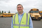 First Student Area Manager Mike Hamel gets the word out about school bus safety tips for students, their parents, and motorists in preparation of the school year. He manages the bus barn at 6755 N.E. Columbia Blvd.