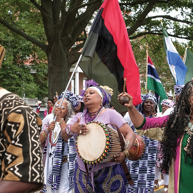 African-American dancers, drummers and flag bearers parade at Fort Monroe on Saturday following more than two hours of speeches. (photo by Ava Reaves)