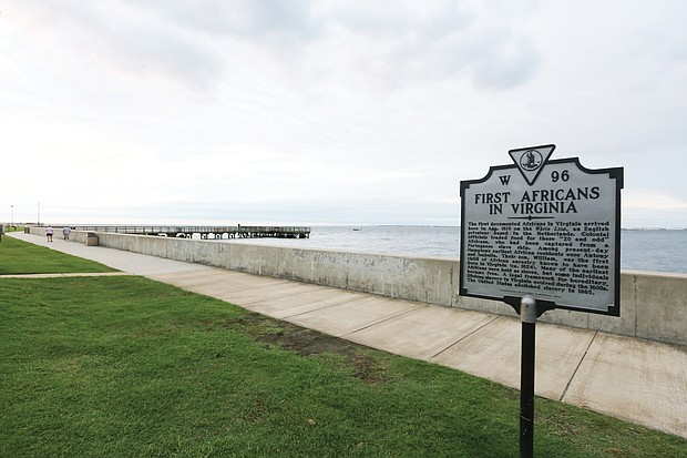 """A state historial marker outlining the history of the """"First Africans in Virginia"""" stands near the seawall at the Fort Monroe National Historic Site. The area was known as Point Comfort in 1619 when the """"20 and odd Negroes,"""" captured by the Portugese in Africa and then stolen by pirates on the English ship White Lion, were traded in Virginia for food and provisions. (Regina H. Boone/Richmond Free Press)"""