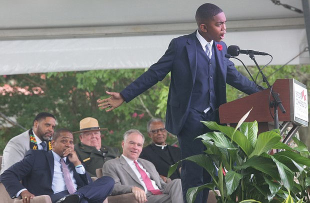 Brycen Dildy, 11, of Larkspur Middle School in Virginia Beach, wows the crowd as he speaks during last Saturday's main commemoration ceremony at Fort Monroe. (Regina H. Boone/Richmond Free Press)