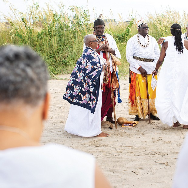 African chiefs lead a sunrise cleansing and African naming ceremony that drew hundreds to Buckroe Beach in Hampton. The solemn event, organized by Roots to Glory, included libations to the ancestors. (photo by Brian Palmer)