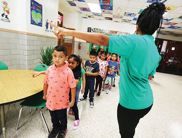 Teacher Abbie Radcliffe and her fourth-grade class at Westover Hills Elementary School line up to welcome Principal Allison El Koubi, Richmond Mayor Levar M. Stoney and Richmond Public Schools Superintendent Jason Kamras on the first day of school.