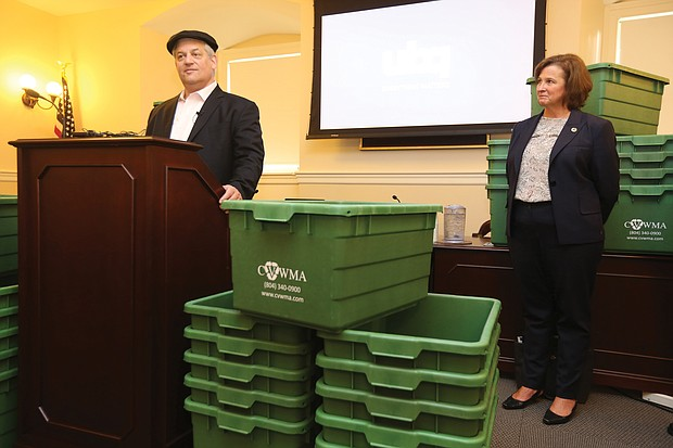 Rabbi Yehuda Pearl, honorary chairman of and early investor in Israel-based UBQ Materials, shows off recycling bins made in part with material UBQ created from household waste. Looking on is Kim Hynes, executive director of Central Virginia Waste Management Authority, the first government agency in the nation to purchase these bins. Location: The State Capitol. The rabbi is founder of Sabra Dipping Co., maker of Sabra hummus.