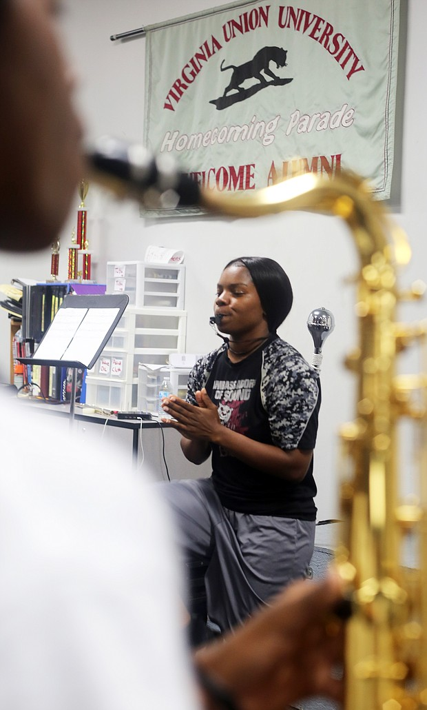 The VUU junior from Portsmouth leads a rehearsal last week, perfecting the moves and the sounds.