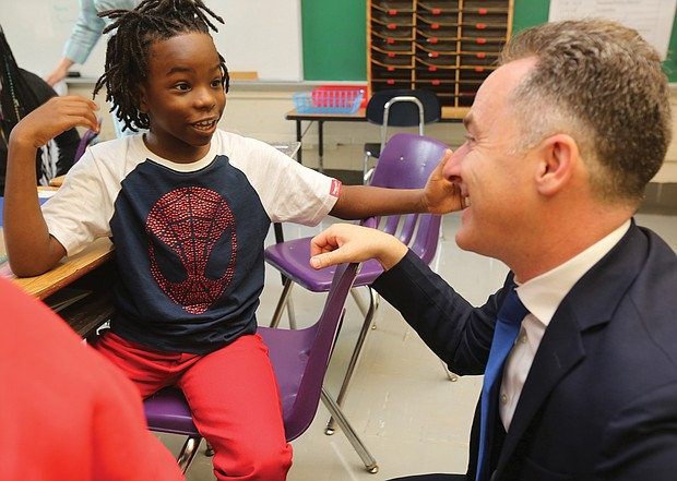 Fifth-grader Akai Dupree Jr., 10, talks with Richmond Public Schools Superintendent Jason Kamras at Westover Hills Elementary School as classes start for the new academic year.
