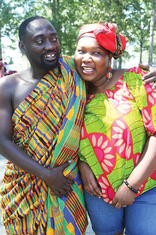 Kojo Marfo wears traditional Kente cloth from the Ashanti region of Ghana as he hugs his wife of 10 years, Anne Odumah Panti. The Richmond couple are natives of Ghana.