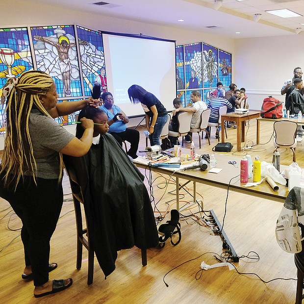 At Cedar Street Baptist Church of God in the East End, youngsters were treated to a Barber and Beauty Day on Monday to get ready for school. A team of professional stylists and barbers worked with youngsters from pre-kindergarten through 12th grade.