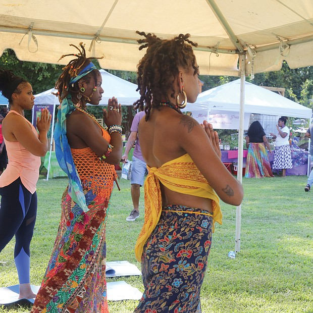 Keeper Sankara leads a yoga flow during the 17th Annual Happily Natural Day last Saturday in South Side. The festival, held at the Fifth District Mini-Farm in the 2200 block of Bainbridge Street, promotes holistic health, cultural awareness and social change.