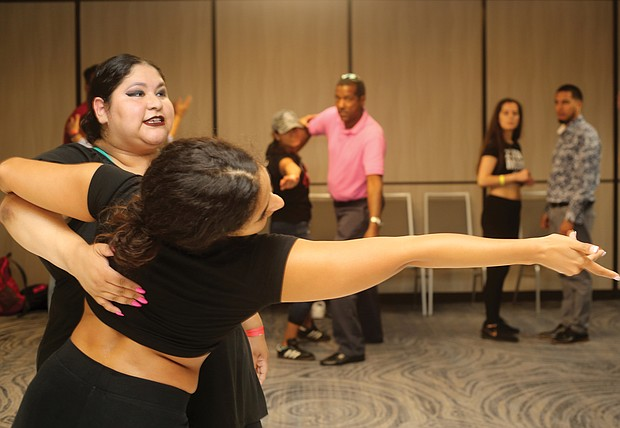 No do-si-do here. The smooth moves of bachata reigned supreme last weekend at the 2nd Annual RVA Bachata Congress held at a Downtown hotel. The three-day event, sponsored by the RVA Salsa Bachata Foundation, featured choreographed dance performances, open dances and workshops for all levels of dancers. Instructor Kat Arias of Washington, owner of Ferocity Dance Company in Falls Church, leads a class with her fellow dance instructor Josette Souza of Washington. (Regina H. Boone/Richmond Free Press)