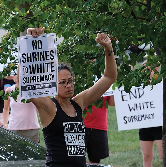 Black Lives Matter activist Jalene Schmidt takes part in a protest last Sunday outside the national headquarters of the United ...