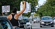 Black Lives Matter activist Jalene Schmidt takes part in a protest last Sunday outside the national headquarters of the United Daughters of the Confederacy on Arthur Ashe Boulevard.